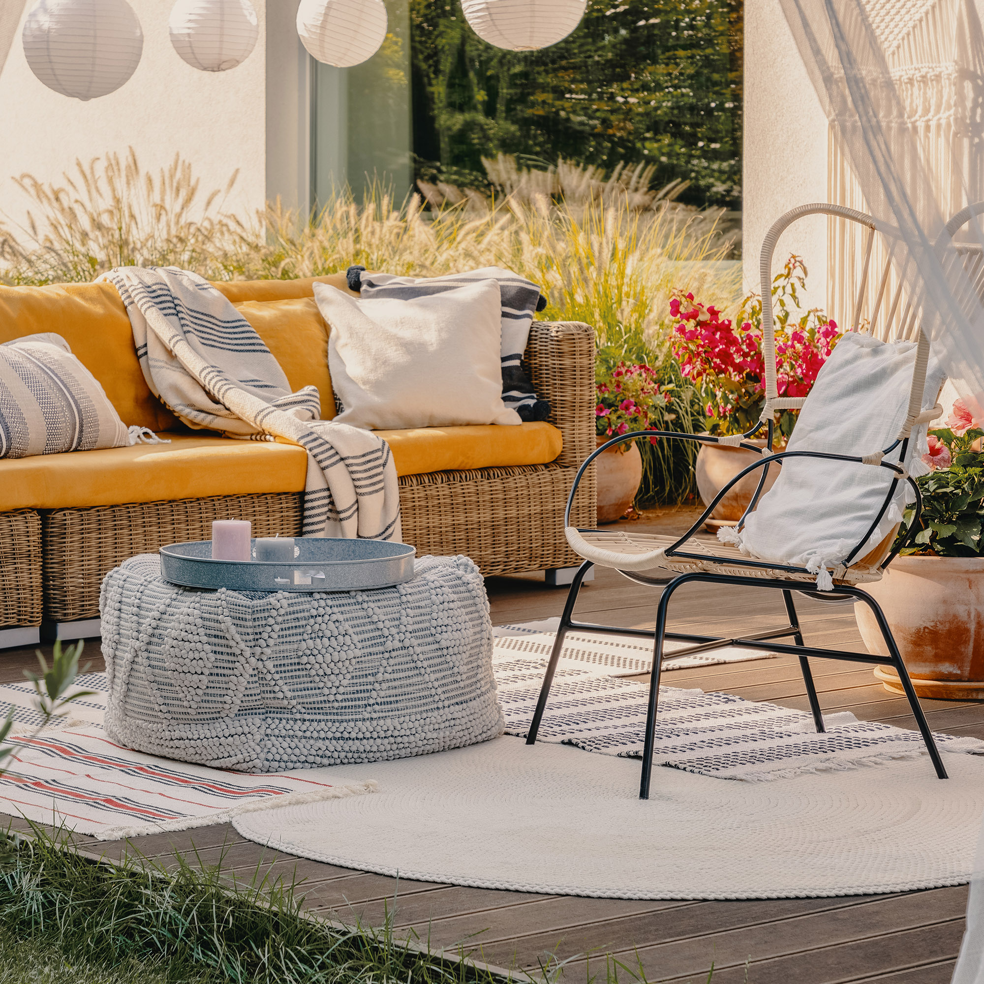 real photo of an armchair, pouf as a table and wicker couch on a